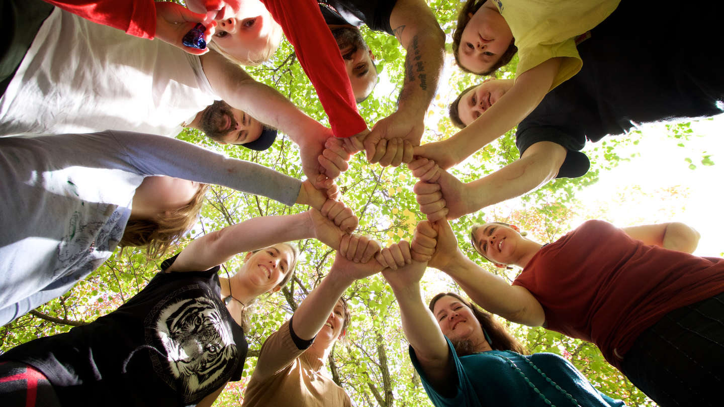 Circle of hands at Community Energy Project in NSW